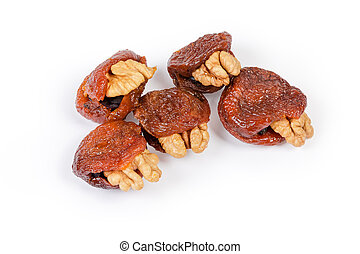 Dried apricots stuffed with walnuts and raisins close-up