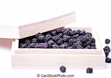 Dried aronia in a wooden box