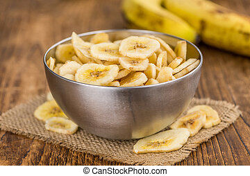 Dried Banana Chips, selective focus - Portion of fresh Dried...