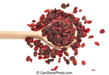 dried barberry in a wooden spoon isolated on white