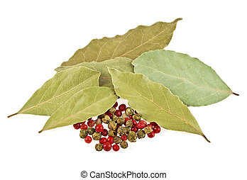 Dried bay laurel leaves and peppercorns on a white background