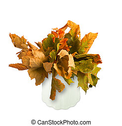 Dried bouquet of autumn leaves in a vase isolated on white background