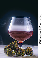 dried cannabis buds (Grandaddy Purple strain) with glass of red wine isolated on black