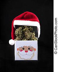 Dried cannabis nugs on box with santa hat - marijuana...