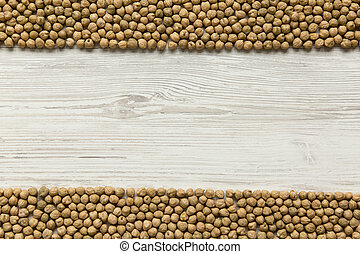 Dried chickpeas on white background, top view. Copy space.