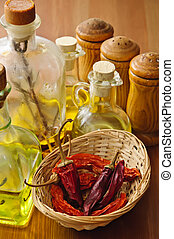 condiments - dried chili with olive oil and condiments on a ...