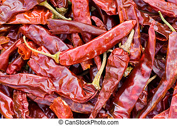 Dried chilli peppers background