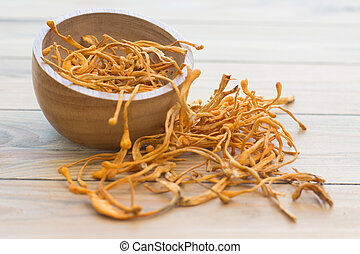 Dried cordyceps militaris on wooden background. chong cao, ...