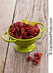 Dried cranberries in a green colander