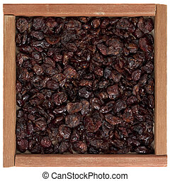 dried cranberries in wooden box
