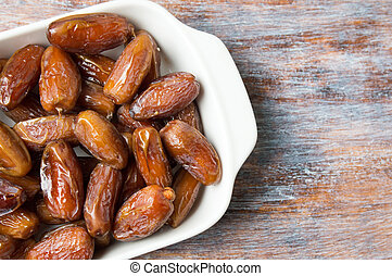 Dried date fruits on a plate