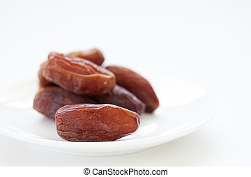 Dried Dates Fruits on dish white background