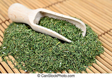 dried dill on table - dried dill on wooden table