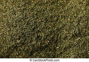 Dried dill powder texture background, close up