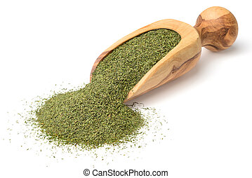 dried dill weed in the wooden scoop, isolated on white ...
