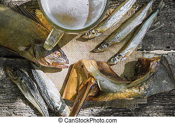 dried fish on wooden background