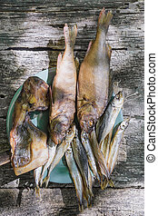dried fish on wooden background vertically