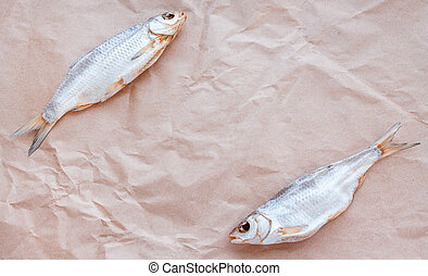 Dried fishes flat lay template banner on craft paper ...