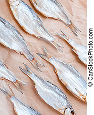 Dried fishes pattern with craft paper background. Vertical ...