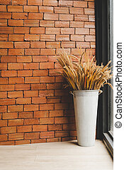 dried flowe in vase decoration with brick wall