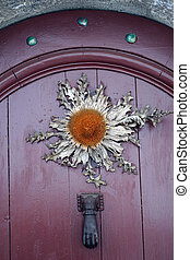 Dried Flower Hanging On A Door