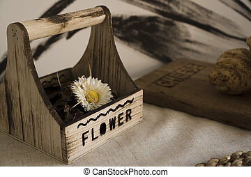 Dried flower in a wooden box on the table. Scandinavian style