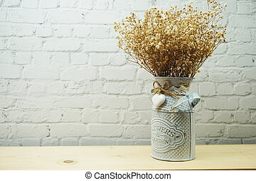 Dried flower in metal vase with space copy on white brick wall background