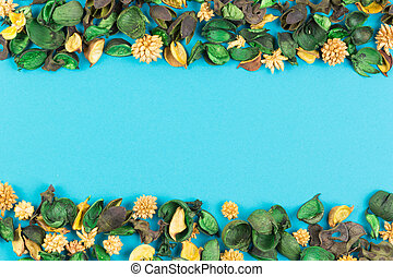 Dried flowers and plants border frame on blue background. Top view, flat lay.