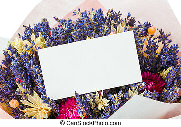 Dried flowers bouquet and paper card