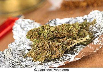 Cannabis - Dried flowers of Cannabis sativa on tinfoil...