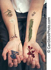 Dried flowers on a woman's hands like tattoos, like veins - ...