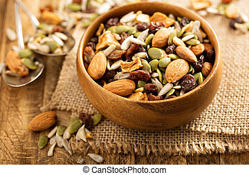 Dried fruit and nuts trail mix with almonds, raisins, seeds...