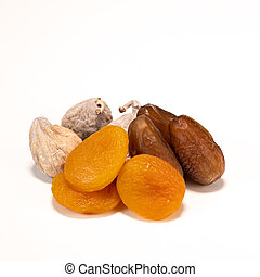 Dried fruit composition, figs, apricots, dates, on white background