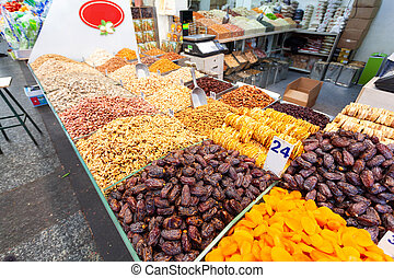 Dried fruits and nuts, beautifully laid out on a counter in a small shop in the Mahane Yehuda market in Jerusalem, Israel