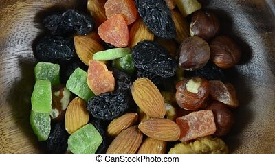 Dried fruits are rotated in a wooden plate