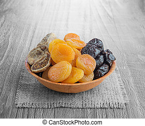 Dried fruits - Dried pitted fruits on a wooden background