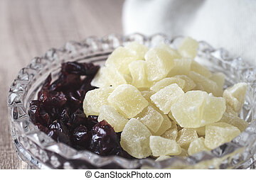 Dried fruits in crystal bowl. Retro colors