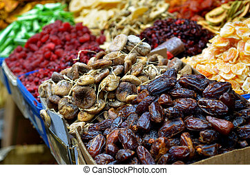 Dried fruits on display in food market in Tel Aviv, Israel. ...