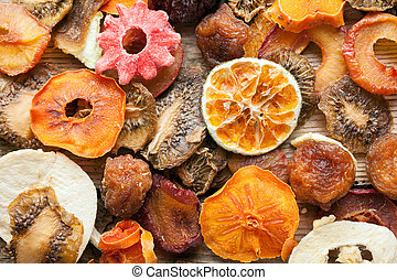 Dried fruits on vintage wooden boards still life