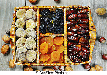 Dried fruits prunes dates apricots figs symbols of holiday...