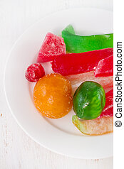 dried fruits with sugar on plate