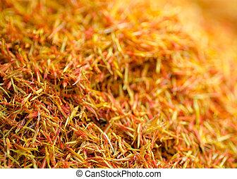 Dried golden saffron on market. Selective focus