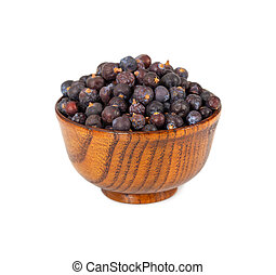Dried juniper berries in wooden bowl isolated on white...