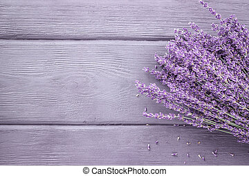 Dried lavender bunches on wooden background. Top view, copy space.