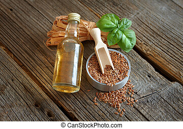 Dried linseed with macerated oil isolated on wooden table