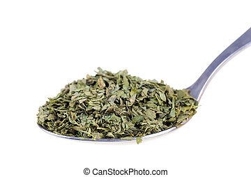 Dried lovage in a spoon isolated on white background