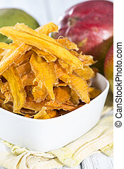 Dried Mango slices in a bowl (close-up shot)