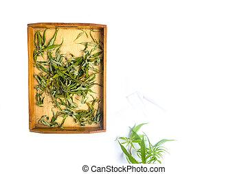 Dried marijuana leafs in a wooden box