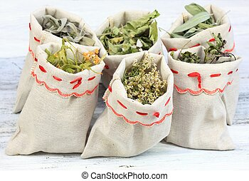 Dried medicinal and culinary herbs in linen  bags
