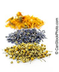 Dried medicinal herbs - Piles of dried medicinal herbs...